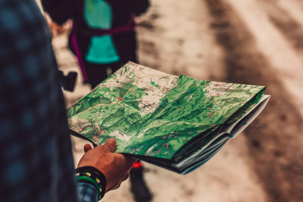 A person holding a map