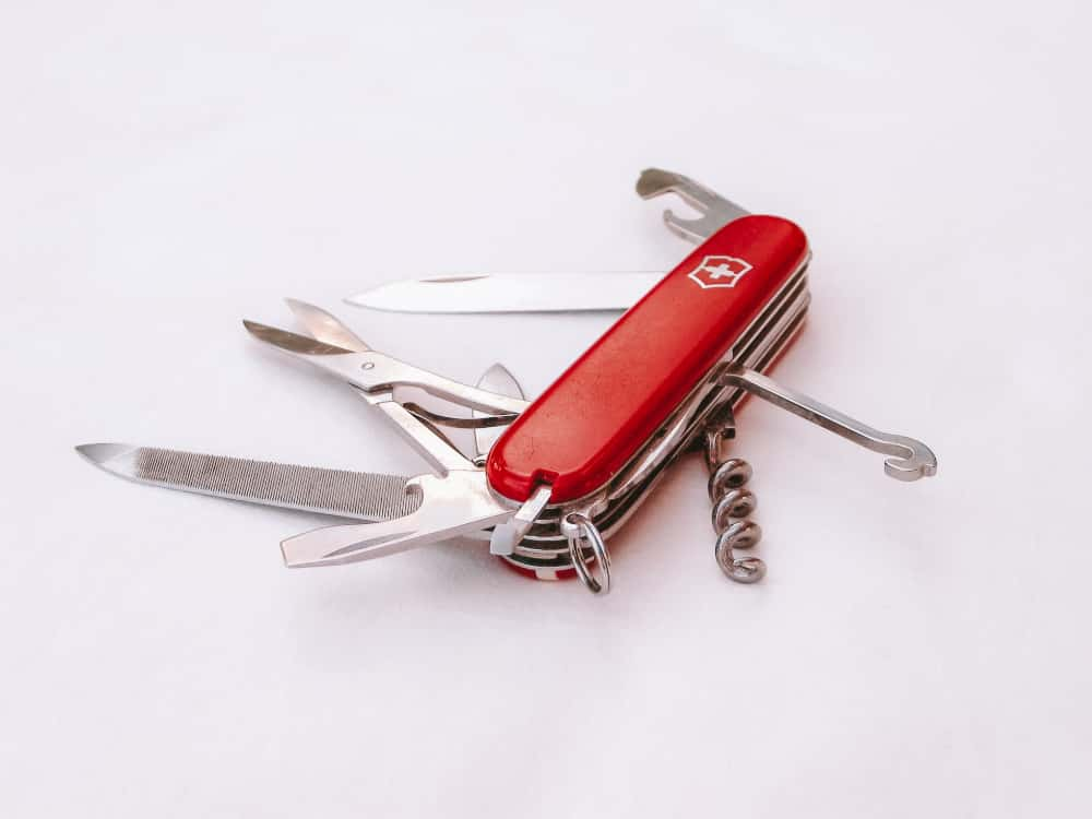 A Swiss army knife with scissors, corkscrew and file
