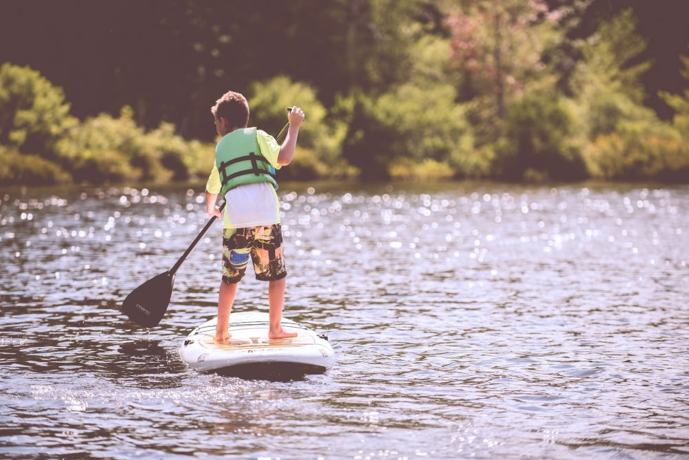 A child paddleboarding