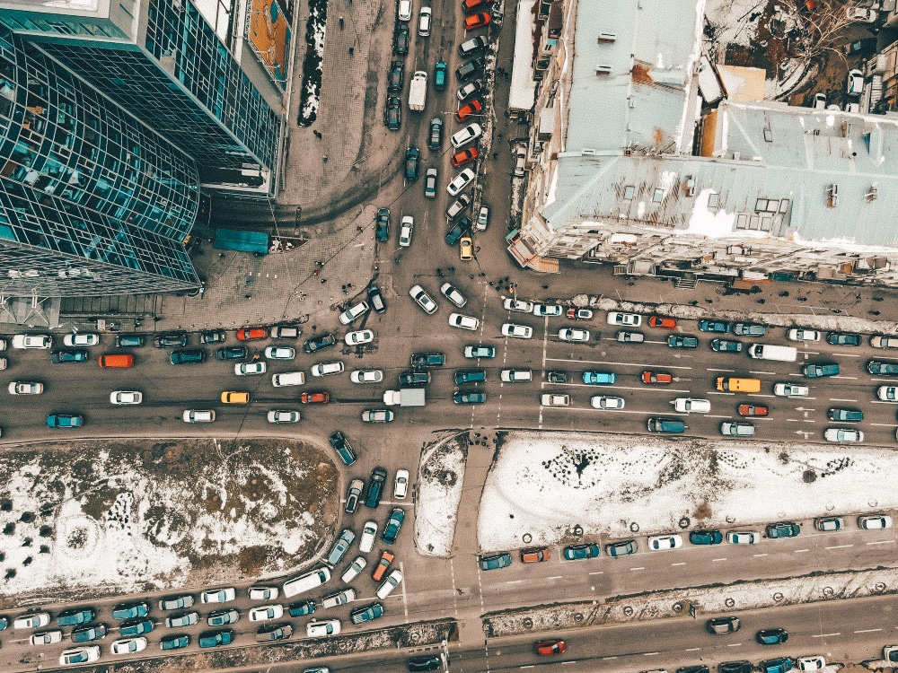 A birds-eye view of a busy traffic intersection