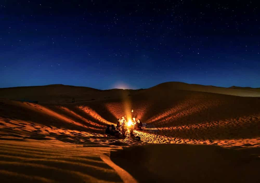 Campfire in desert with friends