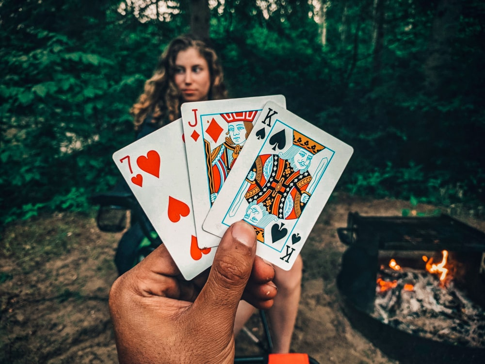 Two people playing a card game