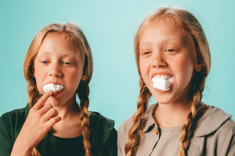 Two girls playing chubby bunny