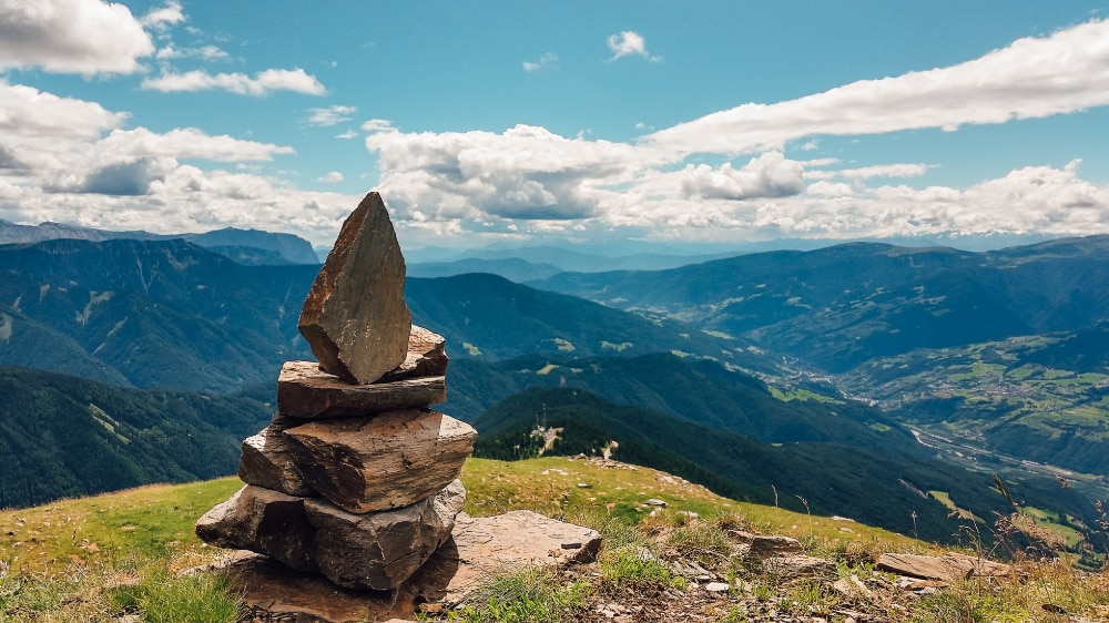 A stack of stones, known as a cairn, marking the summit.