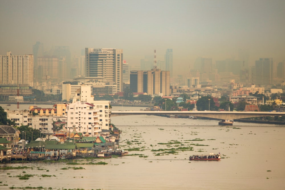 A city covered in thick smog, limiting visibility