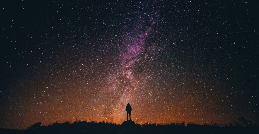 A person looking up at the stars