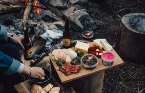 Food platter beside a campfire