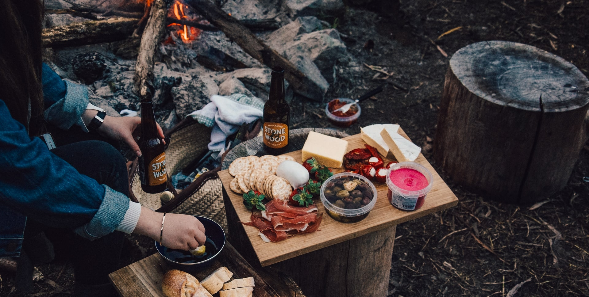 Food platter beside a campfire