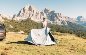 The Quechua instant pop up tent being set up by a happy camper