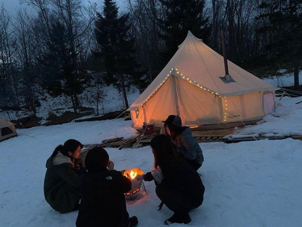 Campers using the DANCHEL Bell Tent in the snow