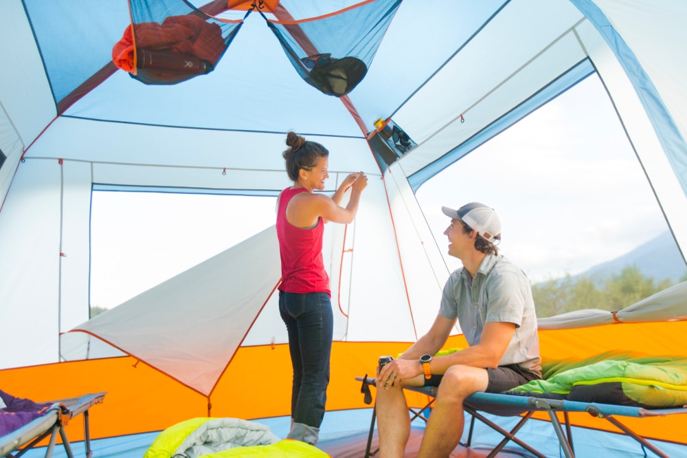 Two campers setting up the Eureka! Copper Canyon, one of our top picks for best cabin tent.
