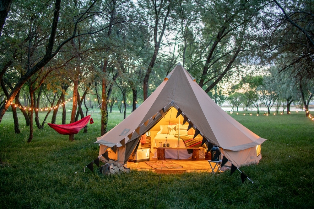 The 10 person TETON Sports Sierra tent, which you can buy from Amazon, beautifully lit by lanterns in the evening
