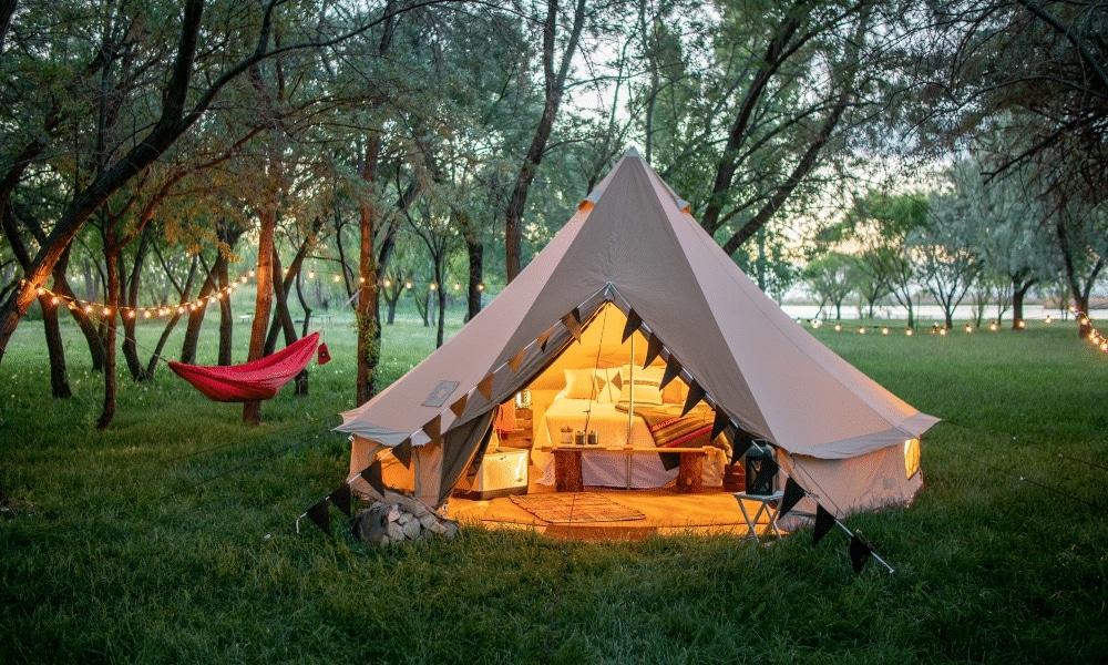 The TETON Sierra tent lit up at night