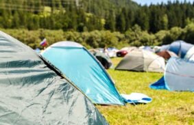 A wide variety of small tents populating a small campsite