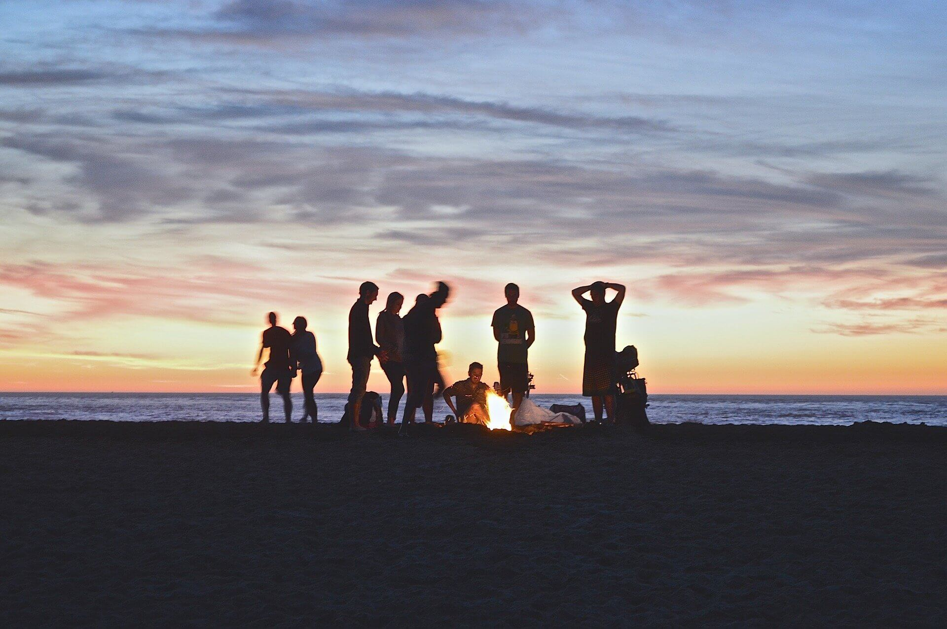 Large group around a campfire by sunset