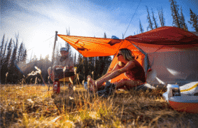 Two campers sat by their Big Agnes Copper Spur