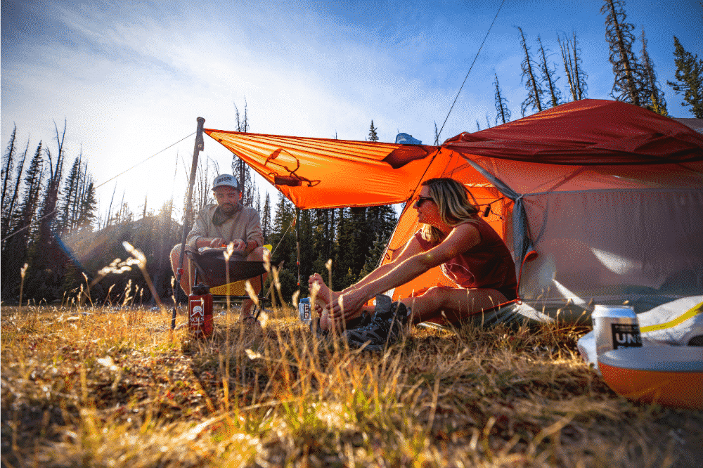 Two campers sat in front of their Big Agnes Copper Spur tent.
