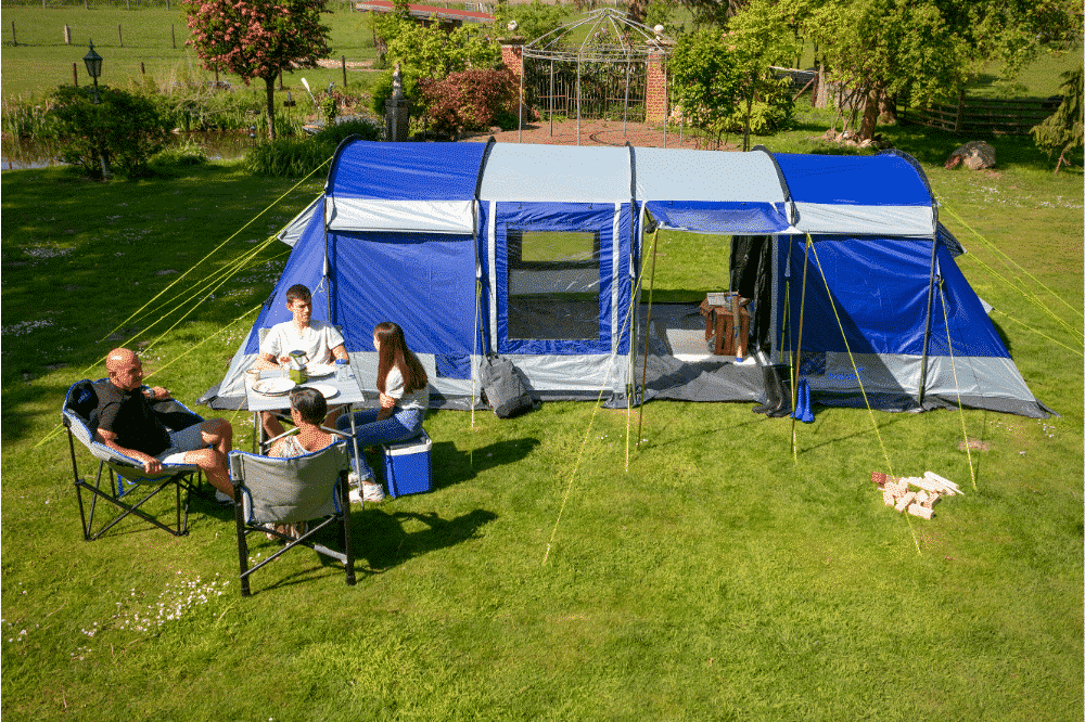 Campers sat outside the Skandika Montana, one of our picks for biggest tent for camping