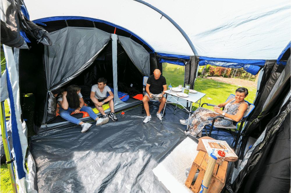 Campers sitting inside the Skandika Montana tent