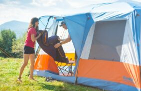 Lifting a sleeping bag out of a Eureka Copper Canyon LX cabin tent