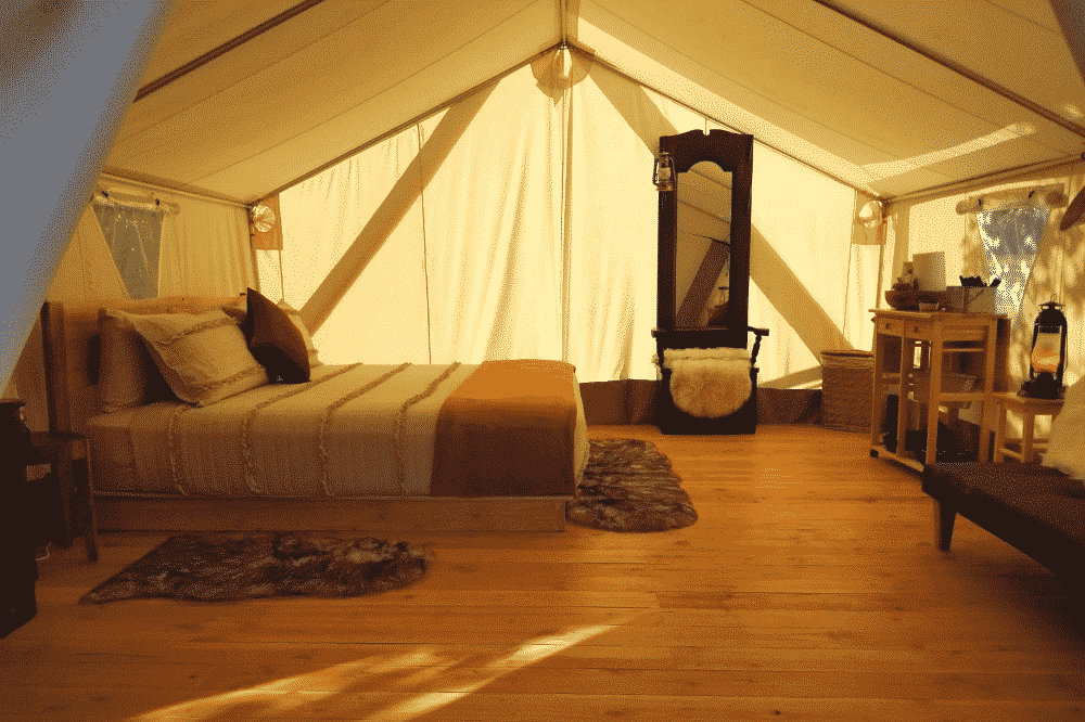 Inside the Whiteduck Wall Tent, which is spacious enough to bring some real furniture for a proper glamping experience. This is why it's the best canvas tent when it comes to comfort.