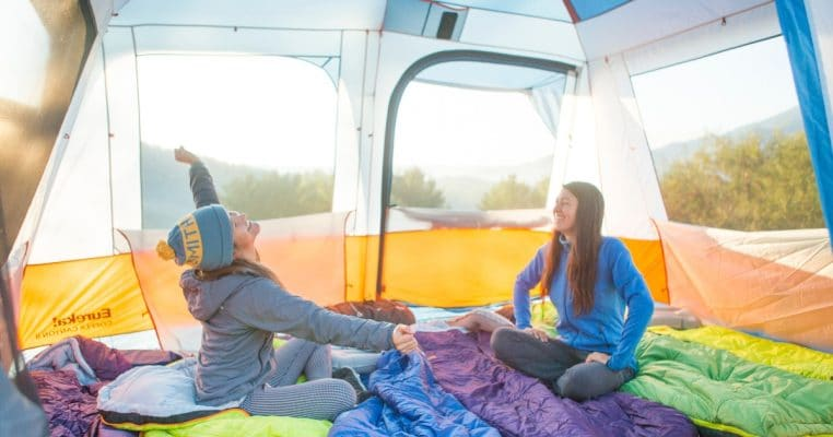 Two campers enjoying the morning in their best 8 person Eureka! Copper Canyon tent