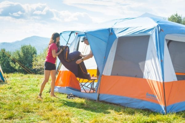 Two campers setting up the Eureka Copper Canyon